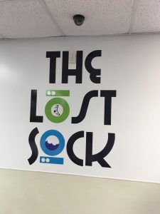 The Lost Sock Custom Lobby Vinyl Sign